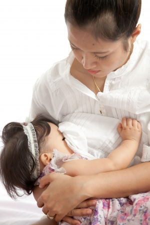 Mother is breast feeding for her baby on white background Stock Photo