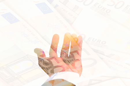 Double exposure. businessman Hand holding open hand on pile 50 Euro banknote. using as financial concept, Business concept, Business risk concept, exchange risk concept, inflation risk concept. Stock Photo