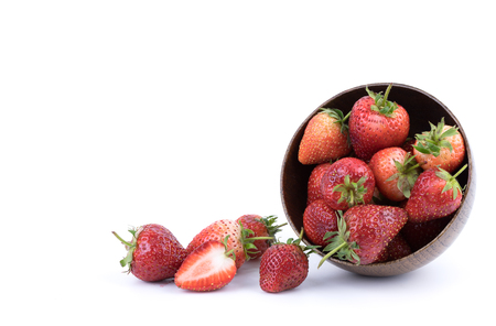 Perfectly retouched fresh strawberry fruit with sliced half isolated on white background. One of the best isolated strawberries you have seen. Selective focus