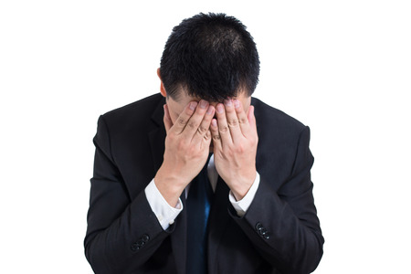 Businessman under stressed with a headache isolated on white background. Disappointed gloomy young man resting his head on hand having suicidal thoughts. Human emotion facial expression, Troubled, Stock Photo