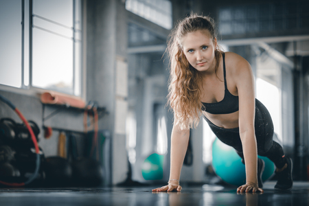 Portrait young attractive healthy woman body curve fitness doing push ups exercises workout with ball in gym. People beauty perfect body slim fitness girl. Freedom happy and relax lifestyle healthcare concept. with copy space. Banco de Imagens
