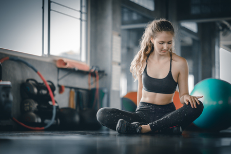 Portrait young attractive healthy woman body curve fitness doing exercises workout with ball in gym. People beauty perfect body slim fitness girl. Freedom happy and relax lifestyle healthcare concept. with copy space. Banco de Imagens