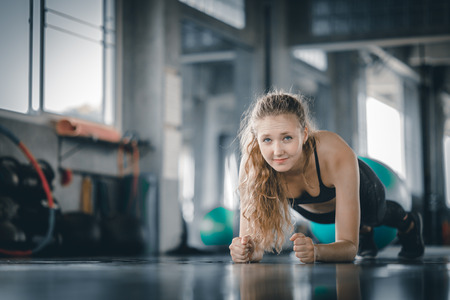 Portrait young attractive healthy woman body curve fitness doing push ups exercises workout with ball in gym. People beauty perfect body slim fitness girl. Freedom happy and relax lifestyle healthcare concept