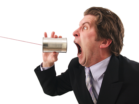 A man screaming on a can phone