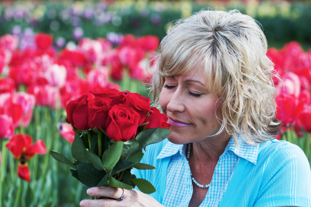 Woman with Red Roses Фото со стока