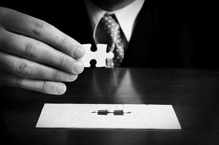Businessman with a puzzle Archivio Fotografico