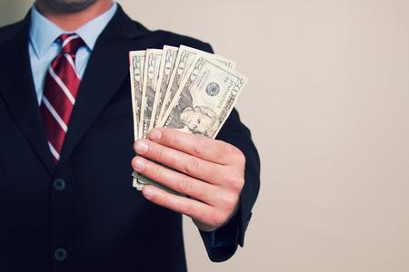 A businessman with money Фото со стока