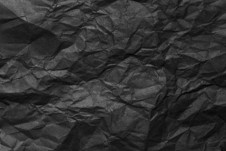 Black crumpled paper Фото со стока