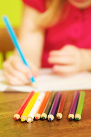 Little girl drawing closeup photo 写真素材
