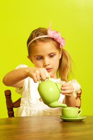 Little girl tea party Фото со стока