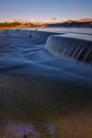 Water flowing smoothly from a dam  photo