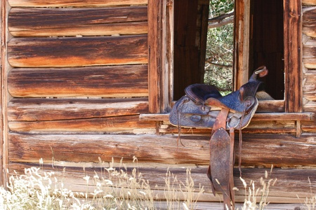 Western saddle on cabin window