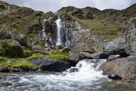 Small Andean waterfall from the snowy verdish. Huancayo, Peru