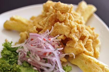 Delicious dish of chicharron of pota accompanied with cassava