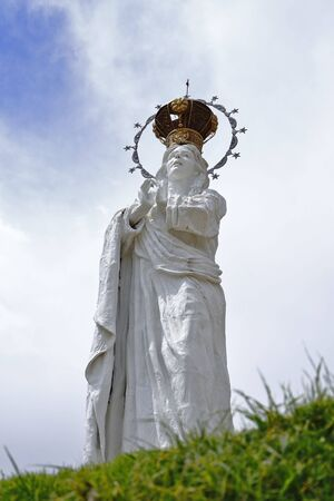 """Detail of the Sculpture of the Virgin of Immaculate Conceptionin the """"stone stop"""" lookout Banco de Imagens"""