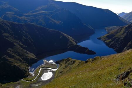 detail of high Andean lagoon located between the hills in the central mountain range of the Andes in Huancavelica