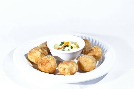 Delicious hot piqueos, small balls stuffed with ceviche, ideal to enjoy as an entry into a seafood restaurant. Stockfoto