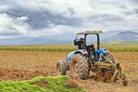 Sicaya. March 23, 2016 - Agricultural machinery doing work turning the soil to prepare it for its next crop to be planted.