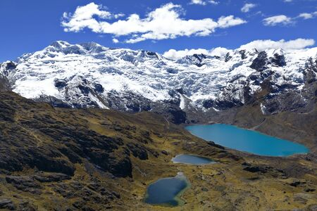 Sunset view of the snowy Huaytapallana next to lagoons in the central mountain range of the Peruvian Andes