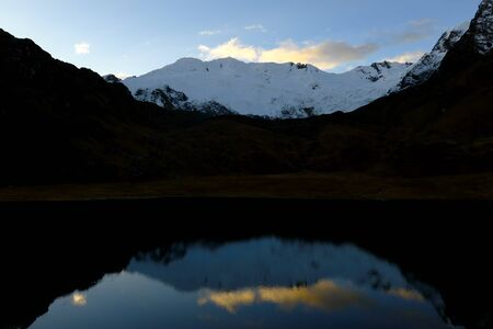 Sunset view of the Huaytapallana snow covered lagoon in the central Andes of Peru. Reklamní fotografie