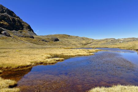 View of a small pond in the Andean heights, in the central mountain range of the Peruvian Andes. Banco de Imagens