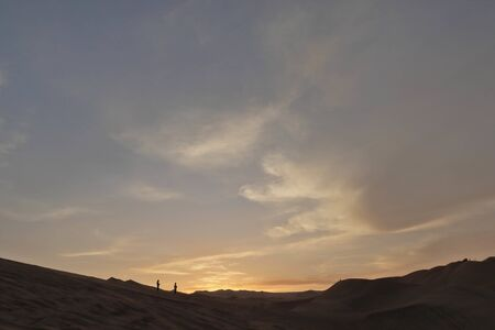 View of the Ica desert from the Huacachina during sunset with the first golden lights. Ica-Peru