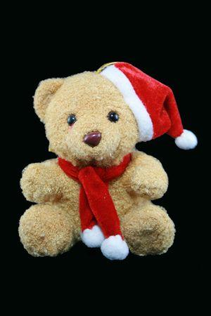 santa teddy bear on a black background