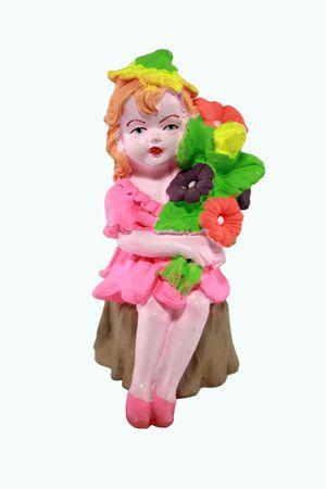 girl elf holding flowers, sitting on a wood stump