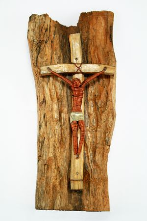 the merciful: copperwire and wooden crucifix on wood and black background