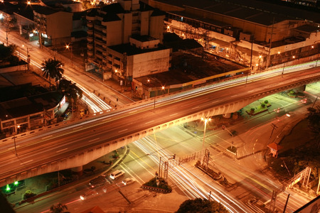 intersection at night with light and motion blur Stock Photo