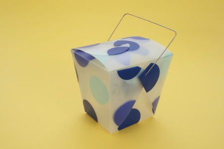 blue dotted oriental carton isolated on yellow background
