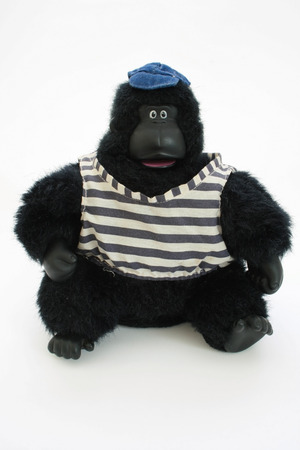 dressed stuffed toy gorilla wearing shirt and hat  Stock Photo