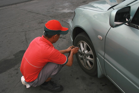 station crew providing free tire air checkup photo