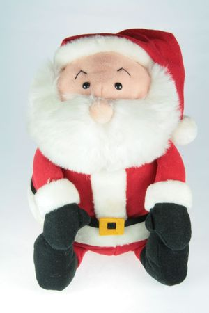 stuffed toy santa claus over white background