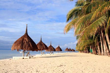 rows of nipa hut along the beach Stock Photo