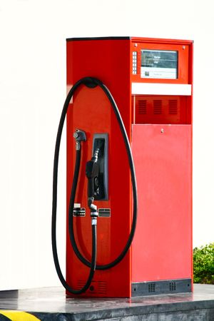 shabby lone gasoline pump on a self-service station Stock Photo