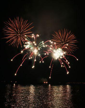 colorful sparkler-like fireworks against the dark sky