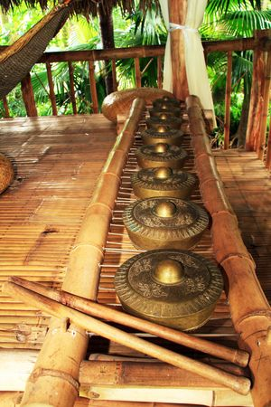 a row of brass gong percussion  instrument also known as kulintang Stock Photo