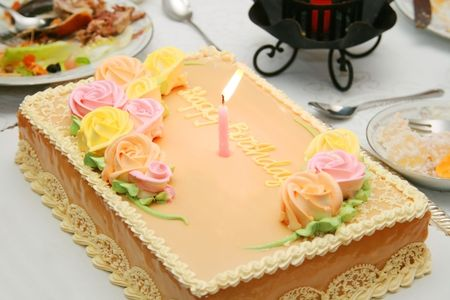 chiffon birthday cake with colorful flower icings
