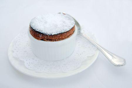dark chocolate souffle served as a dessert