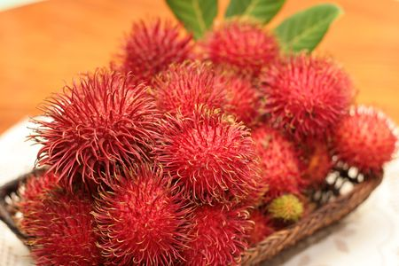 a tray of red hairy rambutan fruitsr