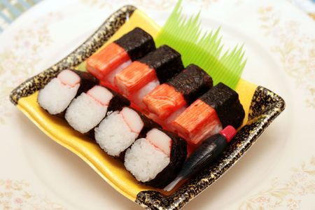 close up of a japanese  kani or crabstick maki