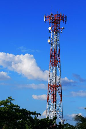 cellular communication tower on a bright sunny day Stock Photo