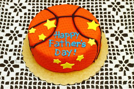 round orange cake with happy fathers day Stock Photo