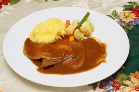 roast beef meal served with mashed potato and vegetable Stock Photo
