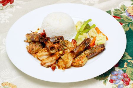 garlic shrimp served with white rice and vegetables Stock Photo