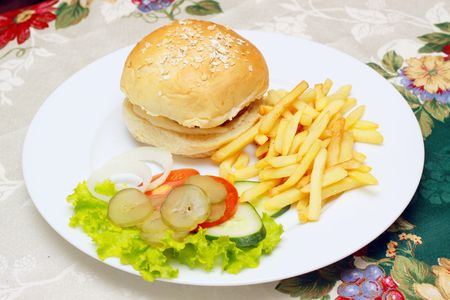 cheese burger and french fries with vegetables  Stock Photo