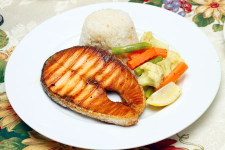 fish fillet stake served with buttered vegetable