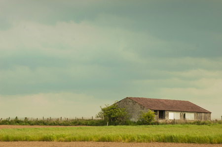 cropland: barn in storm