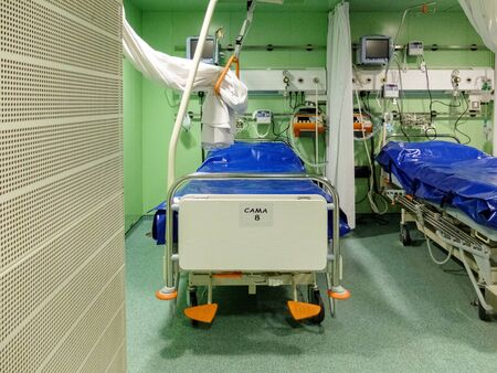 Operating room with stretchers and healthcare supplies